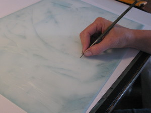 Artist Shana James drawing onto drypoint plate